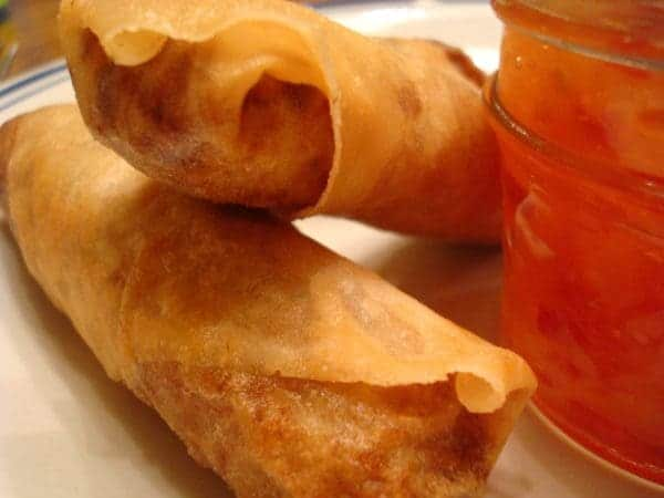 two egg rolls on a white plate