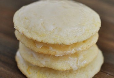 a stack of four light yellow buttermilk cookies on a countertop