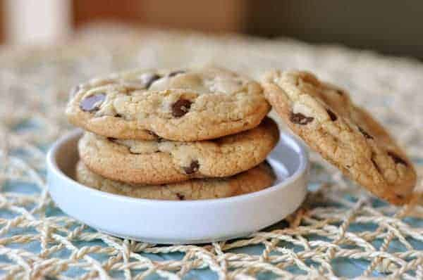 chocolate chip cookies stacked in a white bowl