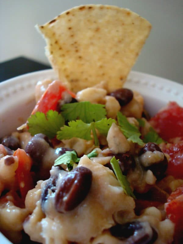 bowl of black bean dip with chip