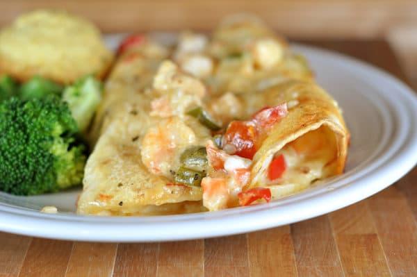 two shrimp Enchiladas on a white plate