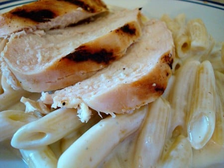 pasta and slices of grilled chicken on a plate
