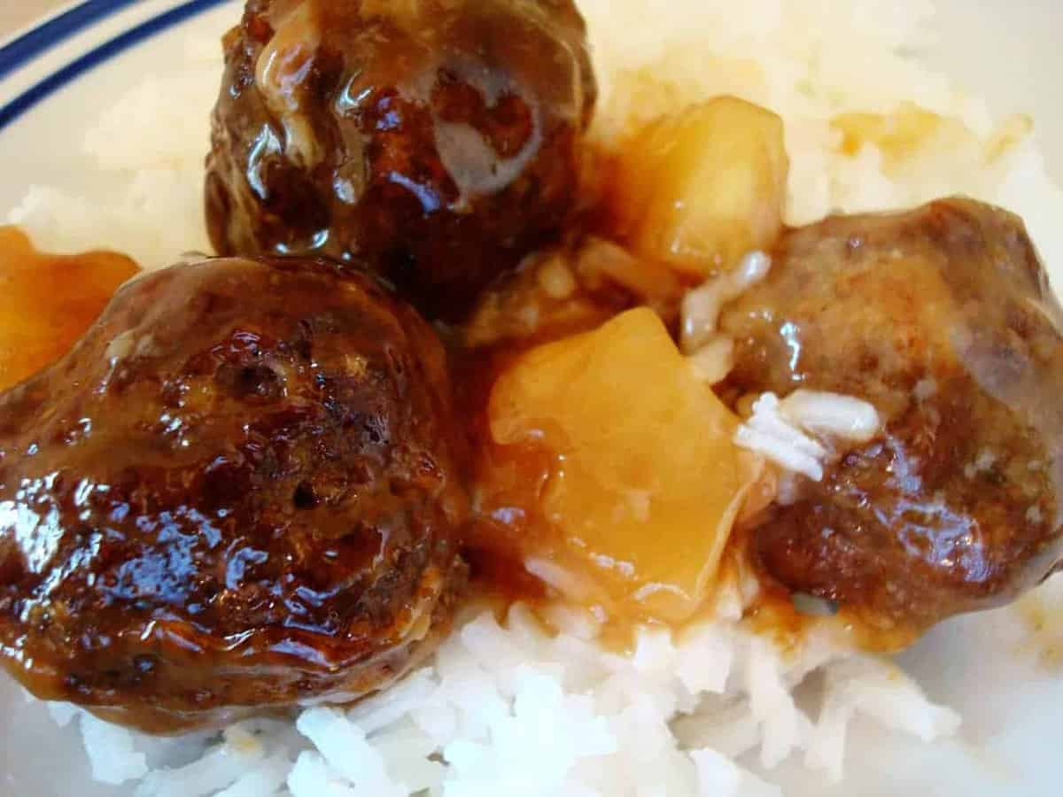 meatballs and pineapple chunks on a bed of rice