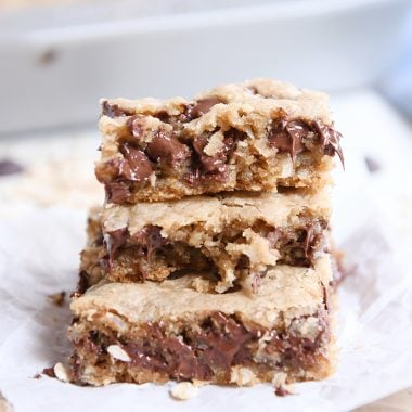 stack of three easy oatmeal chocolate chip coconut cookie bars on white napkin