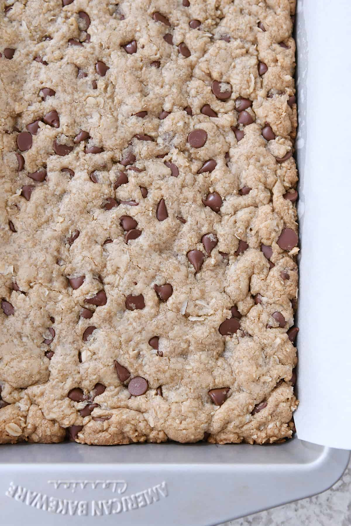 baked easy oatmeal chocolate chip coconut cookie bars in 9X13-inch pan