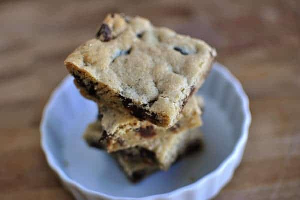 cup up chocolate chunk bars stacked in a white ramekin