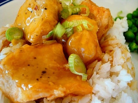 orange chicken on a bed of rice