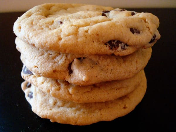 four chocolate chip cookies stacked
