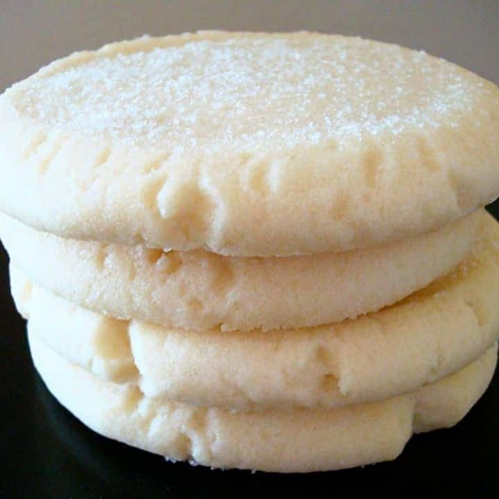stack of sugar cookies on a black plate