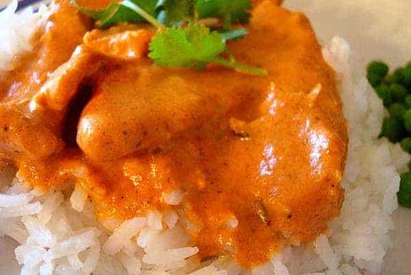 chicken tikka and orange sauce on white rice