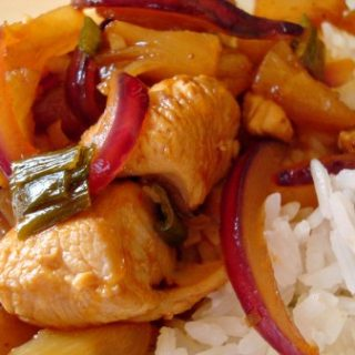 chicken with pineapple and red onion slices on white rice