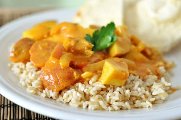 brown rice top with cubed chicken and coconut curry sauce