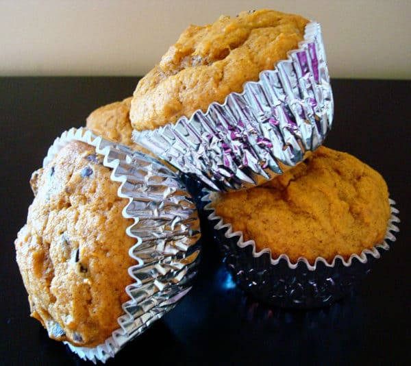 pumpkin chocolate chip muffins in silver liners