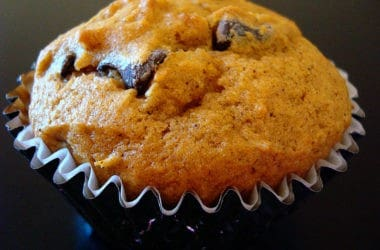 pumpkin chocolate chip muffin in blue muffin liner