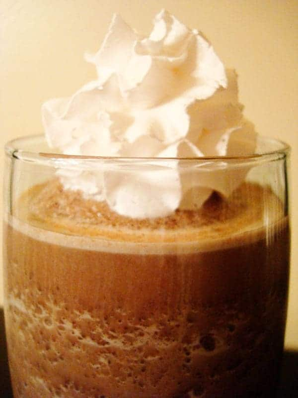 glass of frozen hot chocolate with whipped cream on top
