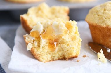 the best cornbread muffins split in half with butter and honey
