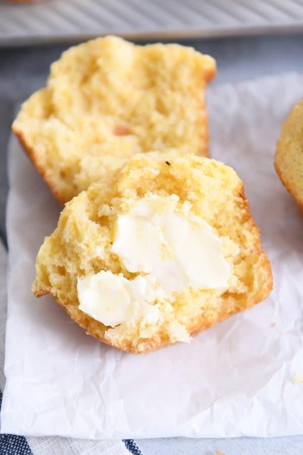 cornbread muffin split in half with butter