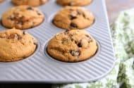 pumpkin chocolate chip muffin in muffin tin