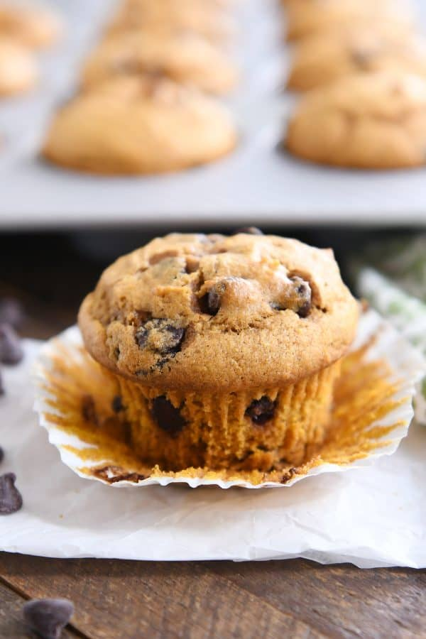 pumpkin chocolate chip muffin with liner pulled down