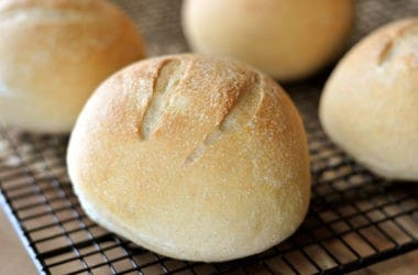 golden brown bread bowls on a cooling rack