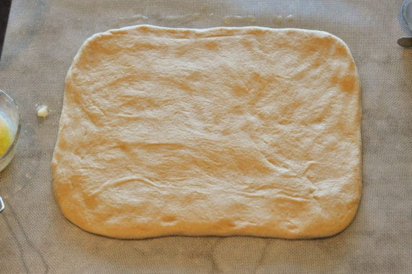 bread dough rolled in a large rectangle