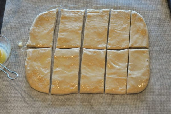 bread dough cut into 10 small rectangles