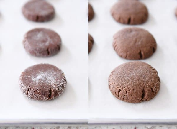 pressed and baked chocolate peanut butter stuffed cookies on parchment paper