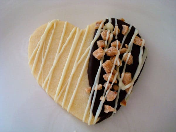 heart shaped sugar cookie drizzled with white chocolate