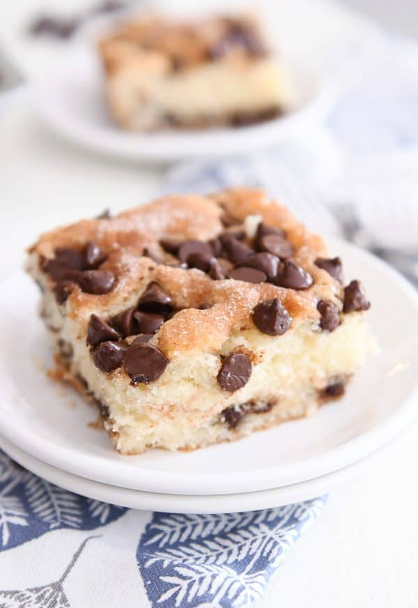 square slice of chocolate chip cake on white plate