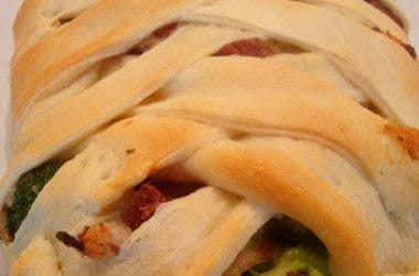 bread with crisscrossed top filled with broccoli and ham