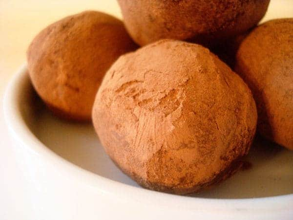 chocolate dusted truffles on a white plate