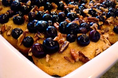 white dish with baked french toast topped with blueberries