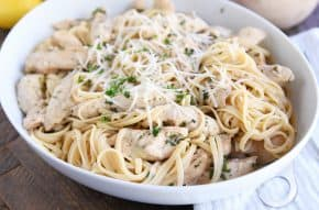 lemon chicken pasta with Parmesan in white dish