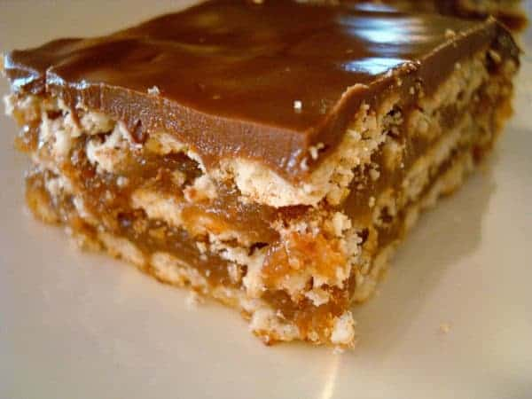 layered caramel crunch bar on a white plate