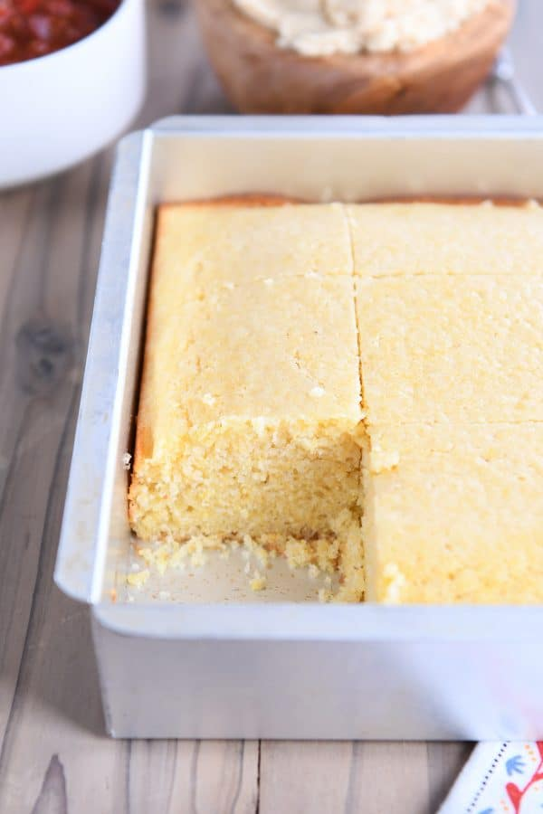 pan of cornbread with piece cut out