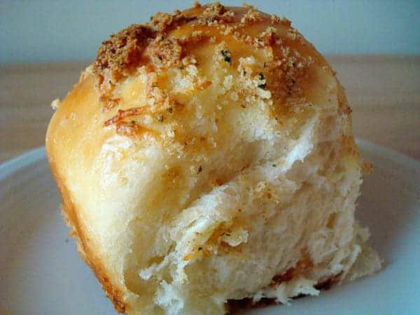parmesan crusted roll on a white plate