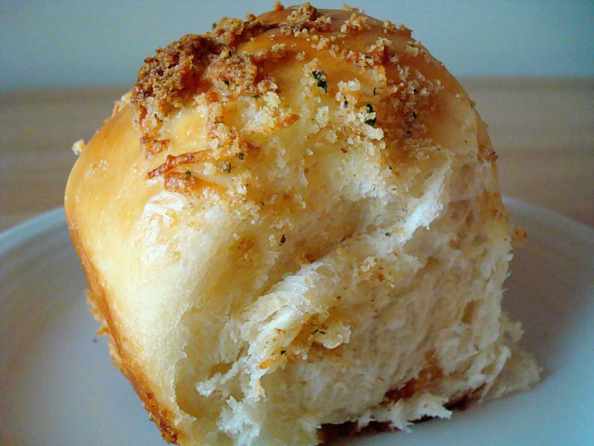 parmesan crusted baked roll on a plate