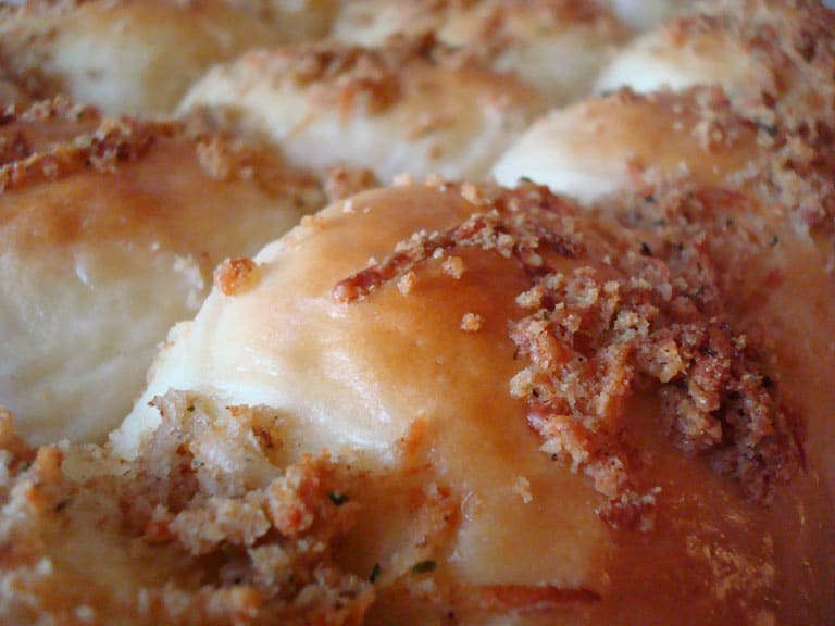 close up of a pan of parmesan and herb crusted rolls