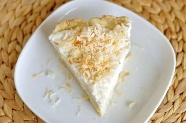 top down view of coconut cream pie on white plate