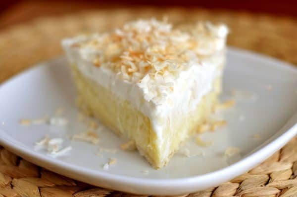 slice of coconut cream pie on white plate