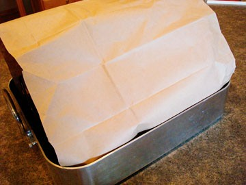 tented turkey in a large roasting pan
