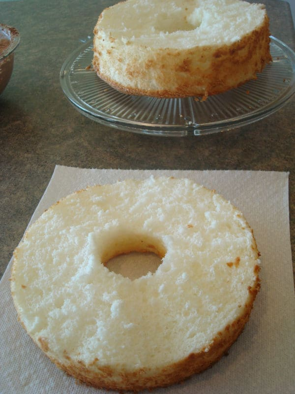 the top layer cut off of an angel food cake
