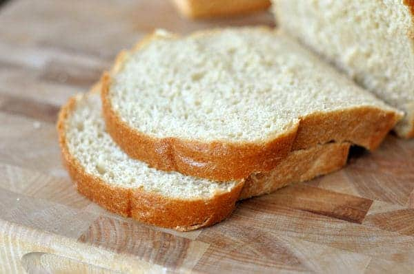 thick slices of whole wheat bread on a cutting board