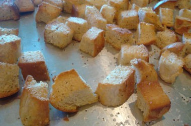 baked bread cubes on a metal cookie sheet