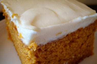 frosted pumpkin bar on a white plate