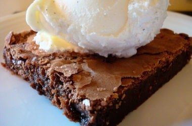 brownie with a scoop of vanilla ice cream on top