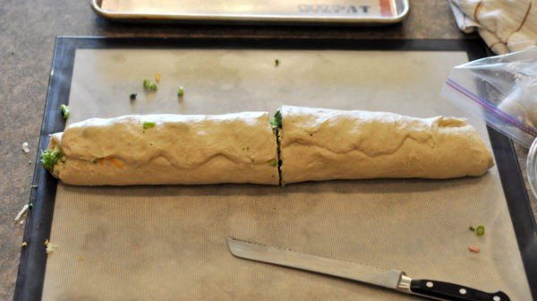 log of bread dough cut in half