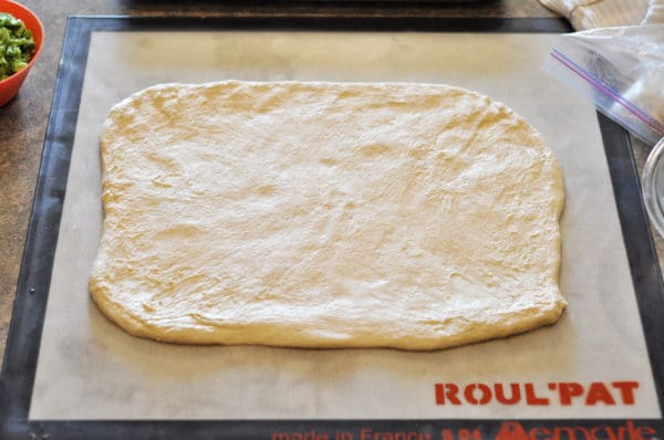 dough rolled into a rectangle on a Roul'pat