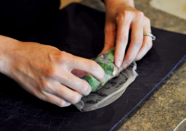 Rolling the last part of a rice wrap up with vegetables in it