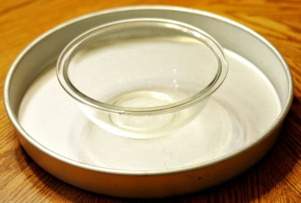 cake pan with a small glass bowl inside